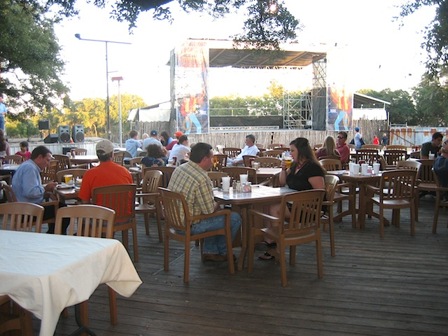 Three Dining Rooms And A Bar Are Inside But In This Weather Most Folks Opt To Dine Out The Open Area Under Huge Oak Trees