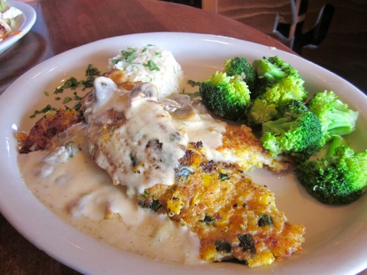 The new cornbread crusted pescado dish at the Iron Cactus restaurant in the Hill Country Galleria in Bee Cave, Texas