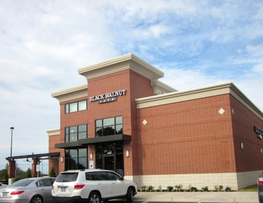 front of the new Black Walnut Cafe at River Place near Austin, Texas