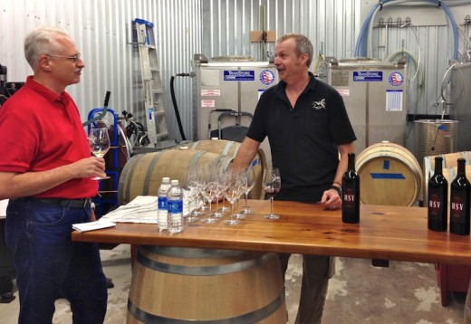 Texas Wine Lover Jeff Cope talks with one of the owners of the new Hawk's Shadow Winery near Dripping Springs, Texas