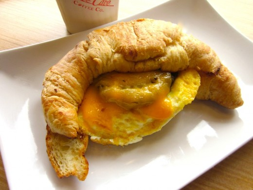 Breakfast croissant with fried egg, cheddar and sausage at the new Bee Cave Coffee Co at the Hill Country Galleria in Bee Cave, Texas