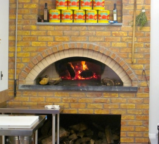 wood-burning pizza oven at the new Fall Creek Enoteca in Marble Falls
