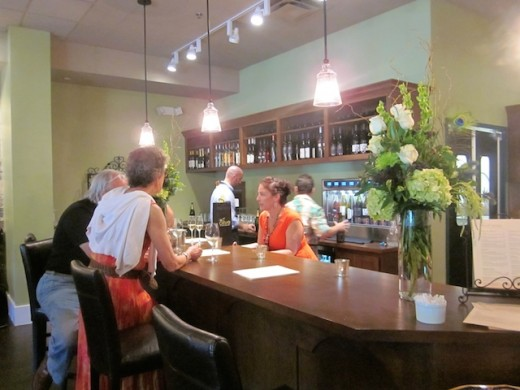 The bar at the new We olive & wine bar at the Hill Country Galleria in Bee Cave, Texas