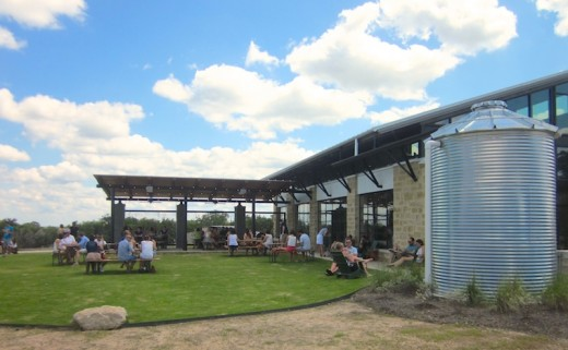 Patio and outdoor seating for the new Deep Eddy Vodka tasting room in Dripping Springs, Texas